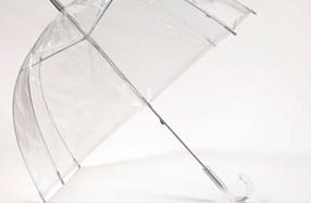 Paraguas transparente con forma de cúpula y mango de estrellas